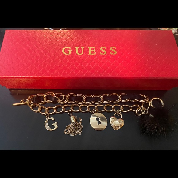 New GUESS gold tone layered charm bracelet